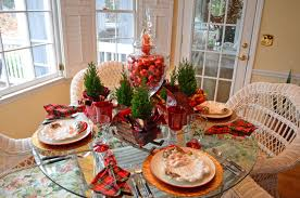 santa themed tablescape with santa plates and a sleigh centerpiece