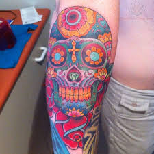 collection of 25 colorful skull on arm
