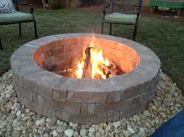 Outdoor Stone Firepits by Rumblestone Firepit With River Stone Surround And Red Lava Rock