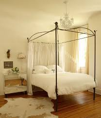 Iron Canopy Bed The Iron Gate Glam Bedroom With Cowhide Rug Iron Canopy