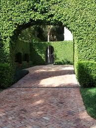 good looking herringbone brick driveway and wonderful hedge