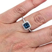 jewelry topaz rings images Princess blue topaz ring diamond halo natural conflict free jpg