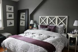 dark grey purple bedroom design with classic small wooden side