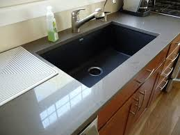 modern white kitchen island with black sink black kitchen sinks