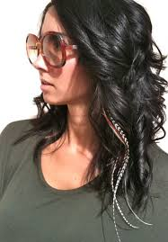 feathers in hair a bold hair statement feather extensions applied