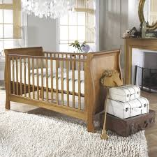 rug for baby nursery wicker pendant lamps white crib baby oval