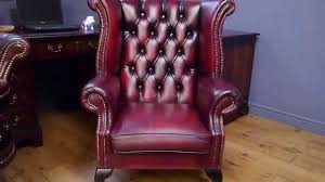 chesterfield chair wing back antique style oxblood red leather