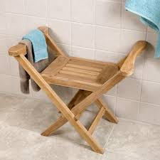 unstained teak wood fold shower bench seat with armrest placed on