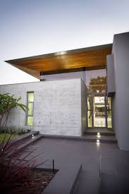 modern glass houses glass front door concrete wall the 24 house in dunsborough