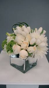 mirrored cube vase wedding centrepiece with white roses and tulips