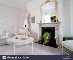 white painted coffee table in cosy country living room with
