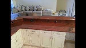 granite countertop setting kitchen cabinets tiled backsplash