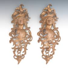 a pair of cast brass rococo style wall ornaments 09 21 13 sold 69
