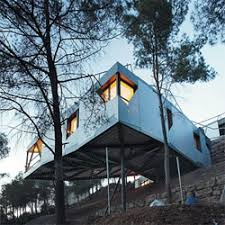 Slope House Add Designed This House Over A Slope With A Complex Roof That Is