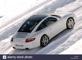 porsche 911 snow porsche 911 targa 4s model year 2006 white driving diagonal