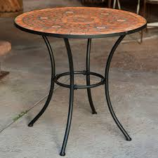 dining room mosaic bistro table in orange with black legs for