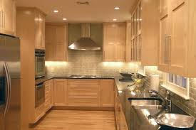 kitchen with light wood cabinets maple cabinets with subway tile backsplash and dark counters