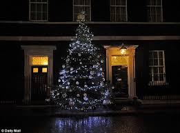 number 10 workers hang lights on tree outside david cameron s