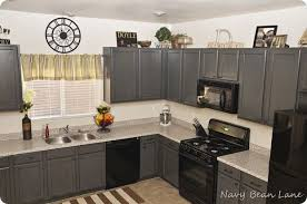 light grey kitchen cabinets with black appliances navy bean gray kitchen cabinets before after