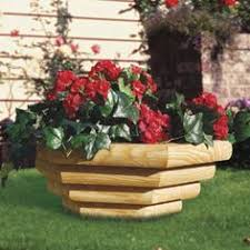 rattle snake planter made from landscape timbers planter