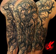 half sleeve evil face tree tattoo for men real photo pictures