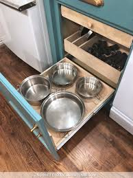 kitchen cabinet storage solutions diy pot and pan pullout diy pull out shelves pots pans organization addicted 2