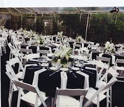 white wedding chairs all black linens all white chairs white napkins this is how