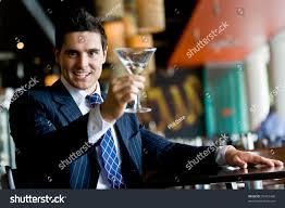 man holding martini businessman martini bar stock photo 25467448 shutterstock