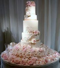 5 tier wedding cake tier wedding cake rising from mound of fresh pink roses jpg