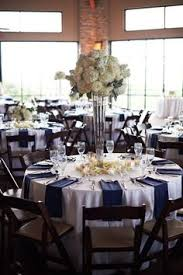 White Roses Centerpiece by Tall White Rose And Hydrangea Centerpiece In A Silver Lined Vase