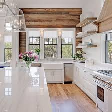 white and wood cabinets beautiful wood paneling and floors to contrast with the white