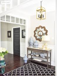 summer home tour with beautiful blues and fresh greenery large entryway with transom details lead to an open concept floor plan summer decorating with