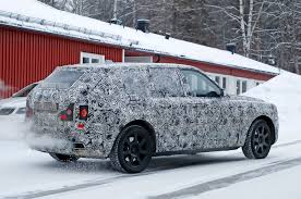 2018 rolls royce cullinan spied rolls royce cullinan shows off suv rear end motor trend