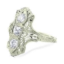art deco diamond ring three stone old european cut diamonds