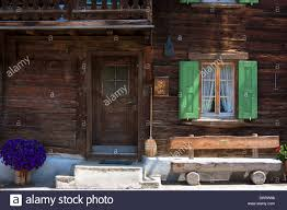 typical swiss wooden chalet style house with straw brush in