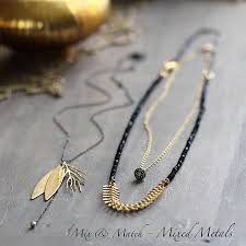 gold and silver mixed metal necklace by artique boutique
