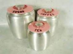 1950s pink kromex spun aluminum kitchen canisters by cominguproses
