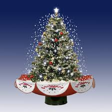 live tabletop tree with decorations and lights