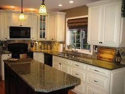 travertine countertops cream colored kitchen cabinets lighting