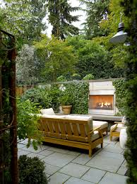 modern outdoor fireplace patio contemporary with bench cushions