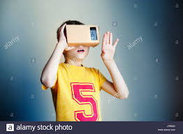 boy with glasses of virtual reality future technology concept