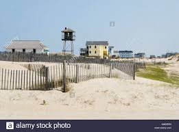 small town beach houses in sand dunes at the seashore actual