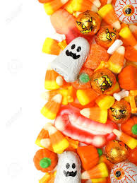 halloween candy vertical border over a white background stock