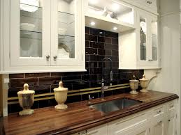 granite countertops white wooden kitchen cabinet and black