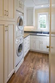 Pinterest Laundry Room Cabinets - stacked washer and dryer and laundry baskets stacked in cabinet