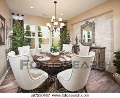 picture of wingback chairs at dining table in house irvine
