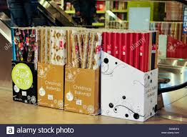 christmas wrapping paper sale rolls of christmas wrapping paper on sale in a shop stock photo