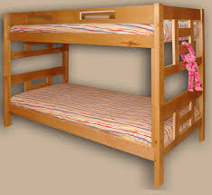 Camper Bunk Bed Sheets by Blue Orange Stripped Bed Sheet Placed On The Light Brown Wooden