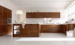 brown wooden kitchen cabinet and single pendant lamp over brown