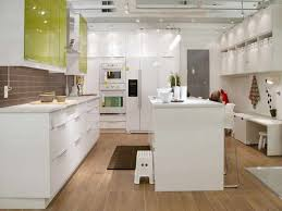 kitchen brown wooden flooring white island full size kitchen black table bar stool grey cabinet hanging lamps